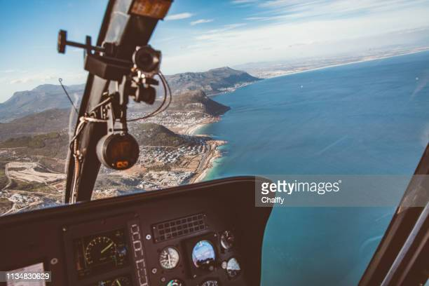 helicopter flight in cape peninsula - inside helicopter stock pictures, royalty-free photos & images