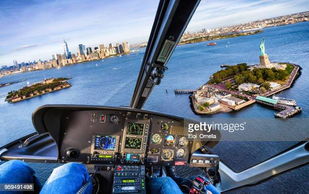helicopter flight in liberty island. new york. usa - helicopter photos stock pictures, royalty-free photos & images