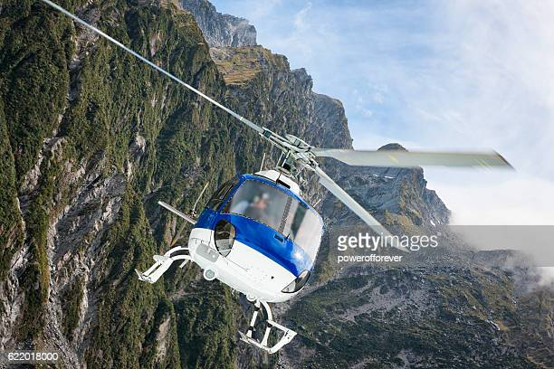 Helicopter flying above the Southern Alps, New Zealand