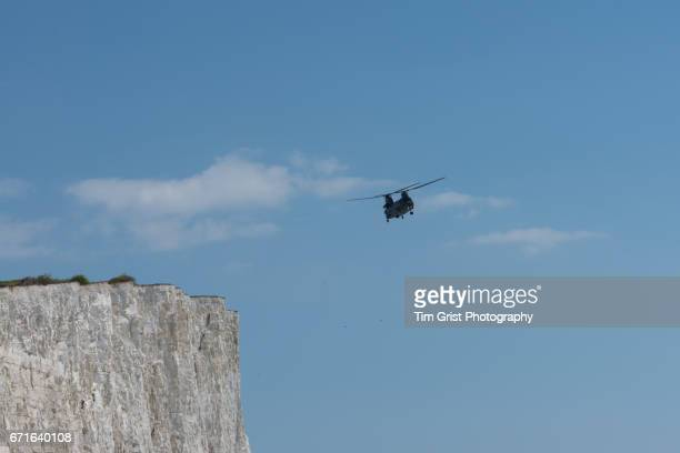 helicopter flying over beachy head - chinook dog stock photos and pictures