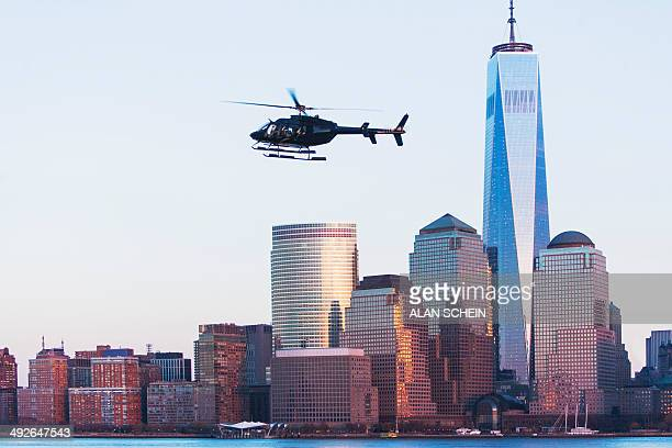 Helicopter flying over city, New York City, New York State, USA