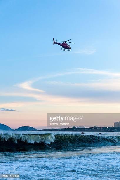 Helicopter flying over Copacabana Beach at sunset, Rio de Janeiro