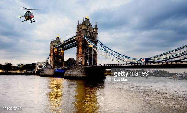 helicopter flying over london, united kingdom - helicopter stock pictures, royalty-free photos & images