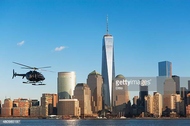 Helicopter flying over river, New York, USA