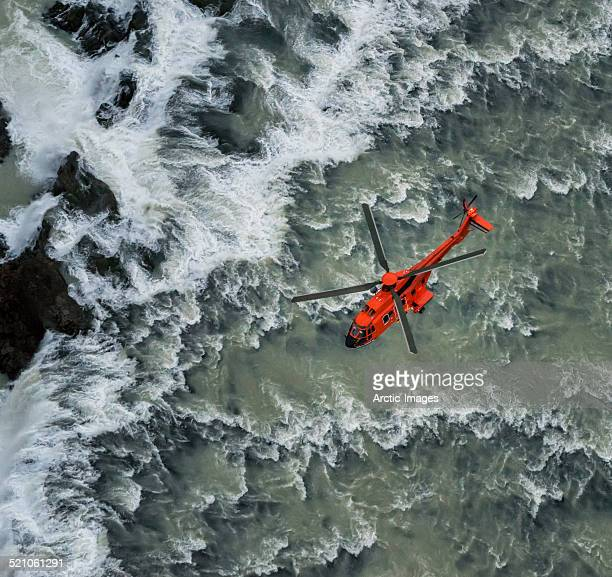 helicopter flying over waterfalls, iceland - rescue stock pictures, royalty-free photos & images