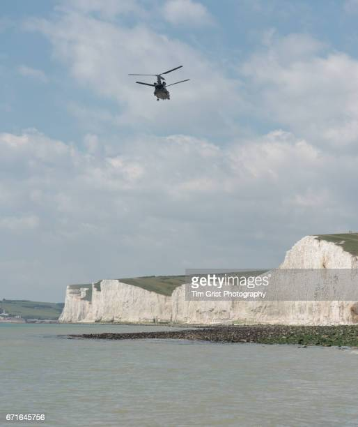 helicopter flying the seven sisters cliffs - chinook dog stock photos and pictures