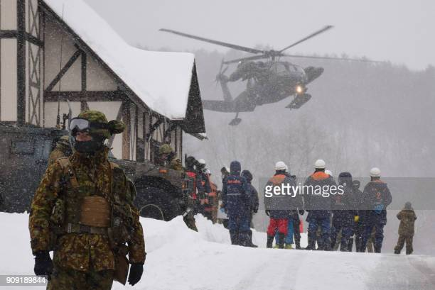 A helicopter from Japan's SelfDefence Force is seen at a ski resort during a rescue operation after the volcanic eruption of Mount KusatsuShirane in...