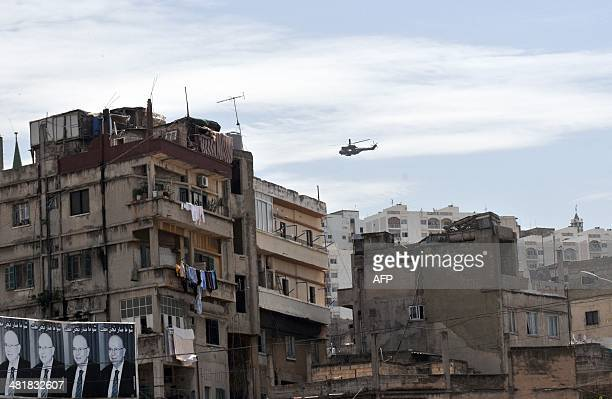 A helicopter from the Lebanese armed forces flies over the neighbouring districts of Jabal Mohsen and Bab elTebbaneh in the northern port city of...