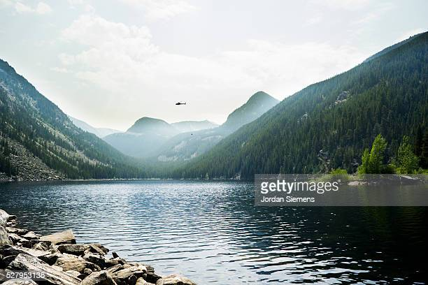helicopter gather water from a lake.