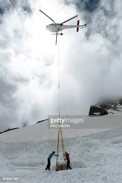 A helicopter helps to lift bottles of wine from the Chateau de Lugey by Bordeaux winemaker Franck Labeyrie from snow near the ski station in...