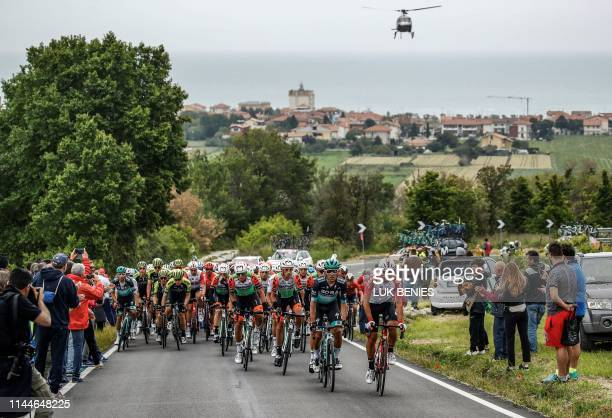 A helicopter hovers behind the peleton as they ride during stage eight of the 102nd Giro d'Italia Tour of Italy cycle race 239kms from Tortoreto Lido...