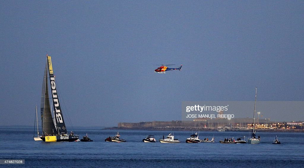 A Helicopter Hovers Near The Team Brunei Yacht As It Sails Up The