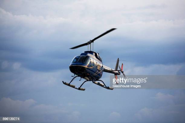 helicopter in flight - helicopter stock pictures, royalty-free photos & images