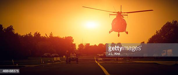 CONTENT] Helicopter in the air above the road on a military base in the netherlands Right in front of a hangar Vehicle aka Jeep on the road with...