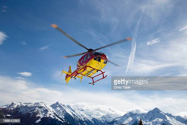 helicopter in the mountains - rescue stock pictures, royalty-free photos & images