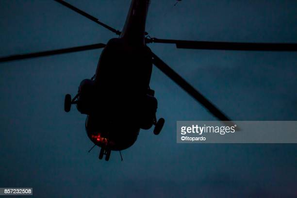 helicopter in the night - helicopter rotors stock photos and pictures