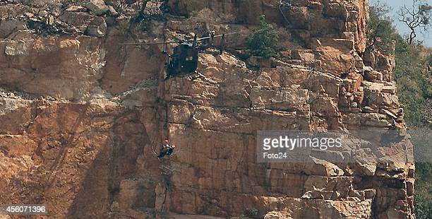 A helicopter is hoisted to rescue Tsenolo Rasello on a mountain on September 21 2014 in Rustenburg South Africa Rescue workers struggled for two days...