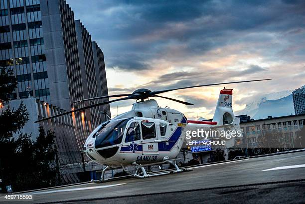 A helicopter is parked in front of the emergency department of the Centre Hospitalier Universitaire hospital in Grenoble French Alps on December 29...