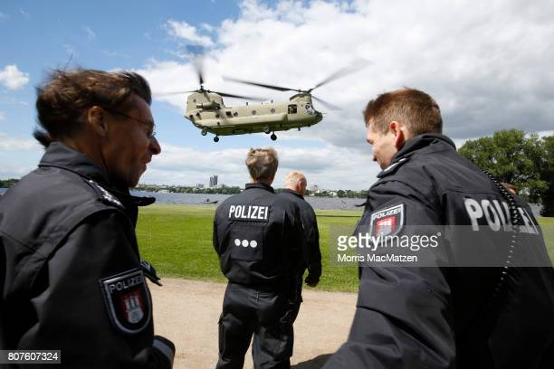 S helicopter is pictured during a touch and go manoeuvre near the Alster lake prior to the G20 Summit in Hamburg on July 4 2017 in Hamburg Germany...