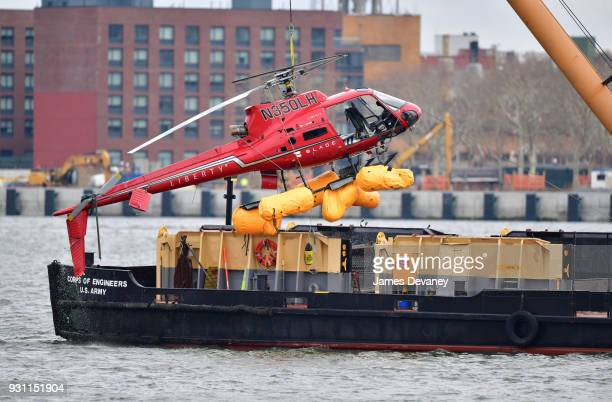 A helicopter is pulled from the East River on March 12 2018 in New York City Five people died after the helicopter made an emergency landing and...