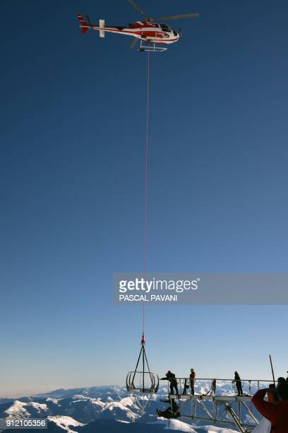 Helicopter is used during the installation of a 12-meter-long platform at the top of the Pic du Midi, one of France's tallest mountains, in...