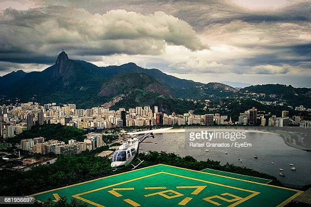 Helicopter Landing On Helipad At Rio De Janeiro Against Cloudy Sky