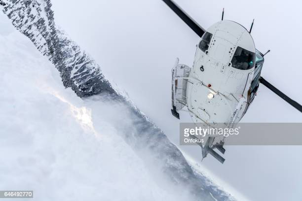 helicopter landing on mountain summit, heli-skiing - helicopter rotors stock photos and pictures