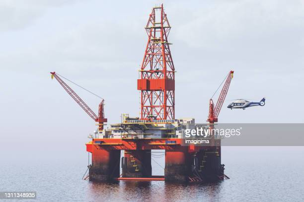 helicopter landing on offshore oil rig - helicopter stock pictures, royalty-free photos & images