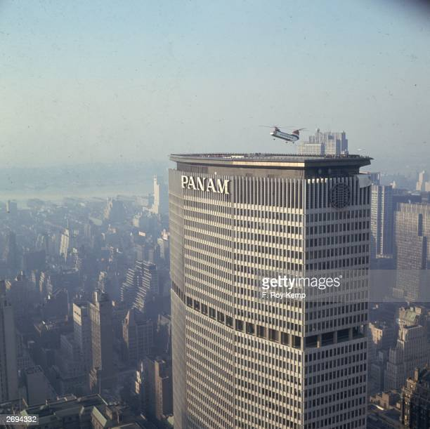 A helicopter landing on the roof of the PanAm building designed by Walter Gropius in New York