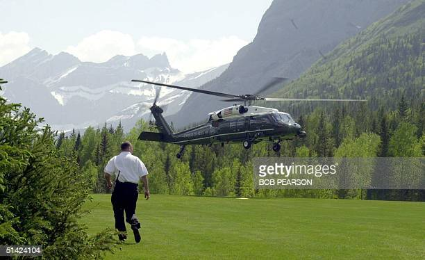 DH60 helicopter lands during a practice approach 22 June 2002 in Kananaskis Alberta Canada site of the G8 Summit of world economic leaders The G8...