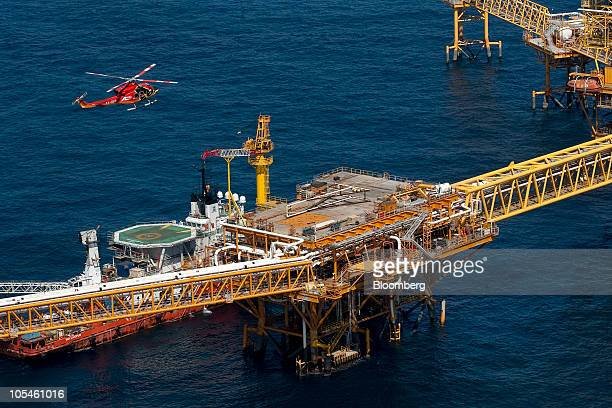 A helicopter lands on a Petroleos Mexicanos offshore platform producing oil from the KuMaloobZaap field in the Gulf of Mexico 65 miles northeast of...