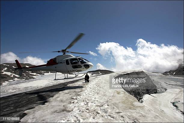 A helicopter lands the scientists in charge of the operation in Rochemelon France on July 28th 2005