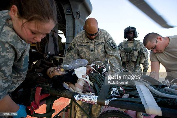 A helicopter lands with an Afghan child requiring treatment at the combat support hospital on the US military forward operating base at Camp Salerno...