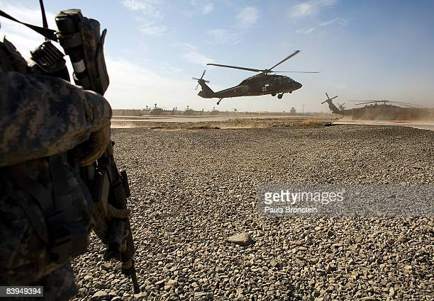 A helicopter lands with seriously injured patients heading for treatment at the combat support hospital on the US military forward operating base at...