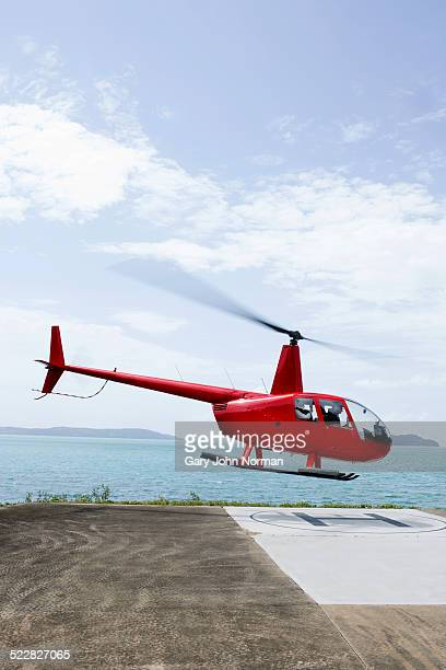 Helicopter leaving island.