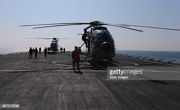 A helicopter lifts off the Amphibious transport dock Kunlun Shan during ChinaRussia Naval Drill Joint Sea2016 on September 17 2016 in Zhanjiang...
