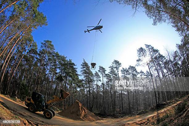 helicopter loading chalk for forest liming
