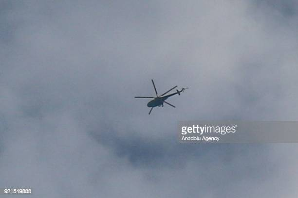 A helicopter of Assad Regime carries out an airstrike over Arbin town of the Eastern Ghouta region of Damascus which is a deescalation zone in Syria...