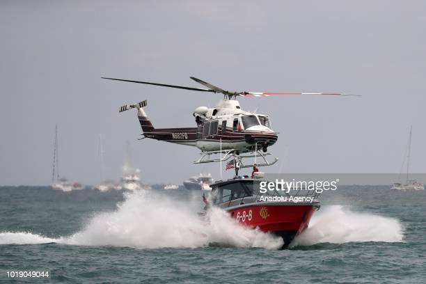A helicopter of Chicago Fire Department performs over Lake Michigan during the 60th Chicago Air and Water Show in Chicago United States on August 18...