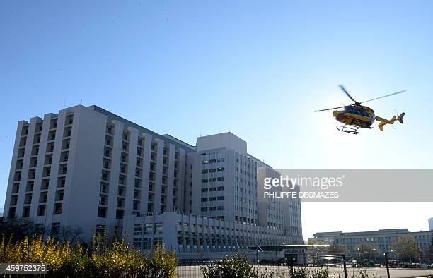 A helicopter of the civil security takes off on December 30 2013 at the Grenoble University Hospital Centre French Alps where Michael Schumacher the...