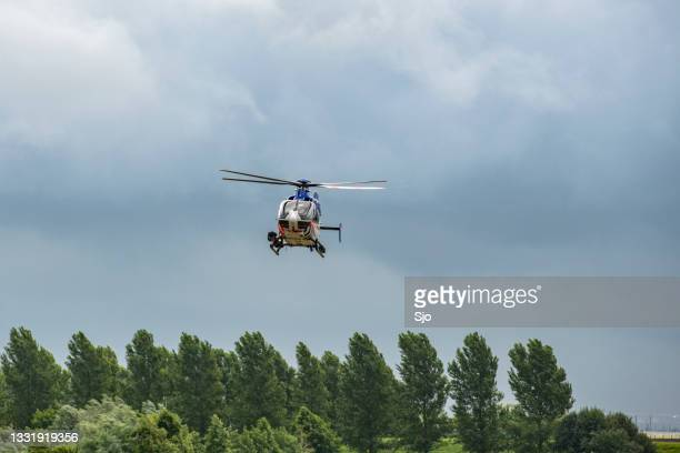 """helicopter of the dutch police aviation service flying - """"sjoerd van der wal"""" or """"sjo"""" stock pictures, royalty-free photos & images"""