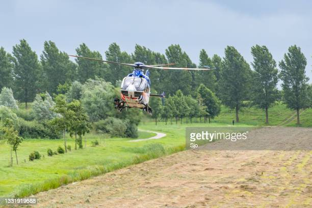 """helicopter of the dutch police aviation service landing - """"sjoerd van der wal"""" or """"sjo"""" stock pictures, royalty-free photos & images"""
