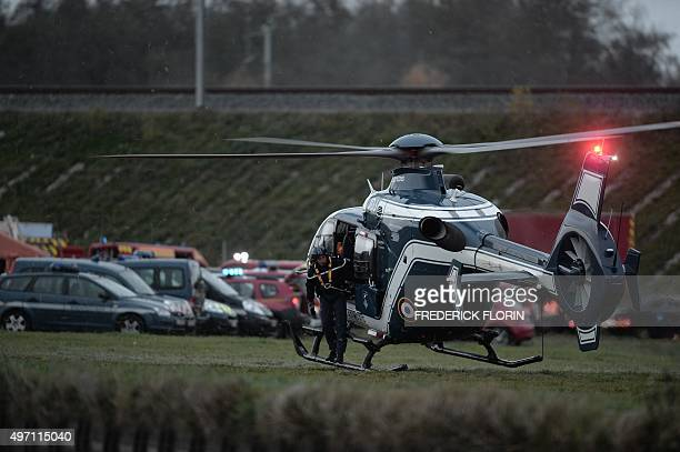 A helicopter of the French Gendarmerie stands by at the scene where a highspeed TGV train coach and engine carriage derailed into a canal in...
