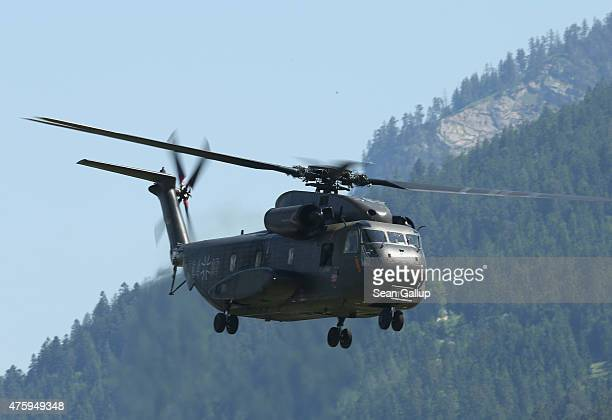 A helicopter of the German armed forces the Bundeswehr departs from a field two days before the summit of G7 leaders on June 5 2015 in...