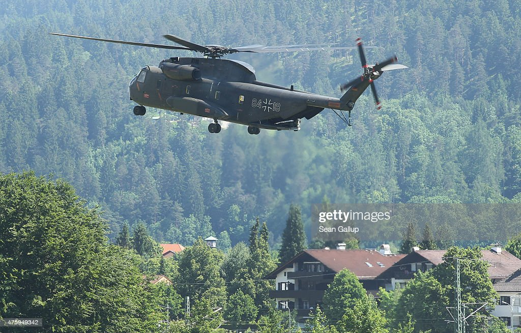 A helicopter of the German armed forces, the Bundeswehr, lands at a field two days before the summit of G7 leaders on June 5, 2015 in Garmisch-Partenkirchen, Germany. G7 leaders will meet at nearby Schloss Elmau on June 7-8 and at least 17,000 police members are on hand to safeguard security at the summit.