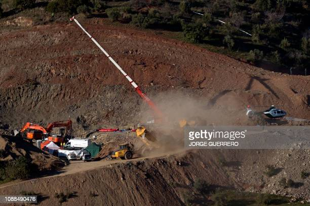 A helicopter of the Spanish Guardia Civil transporting explosives lands at the site where a child fell down a well in Totalan southern Spain on...