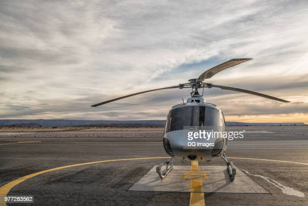 helicopter on landing pad at dusk, las vegas, nevada, usa - helicopter photos stock pictures, royalty-free photos & images