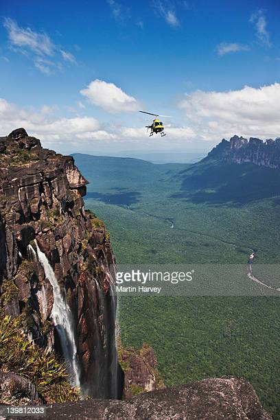 helicopter over angel falls, canaima national park, venezuela, south america - angel falls stock photos and pictures