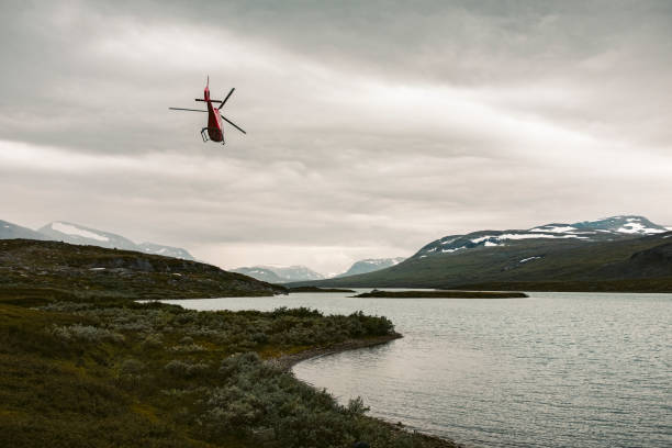 Helicopter over lake in mountains