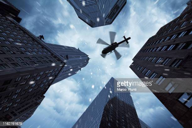 helicopter over new york city - terrorism stock pictures, royalty-free photos & images